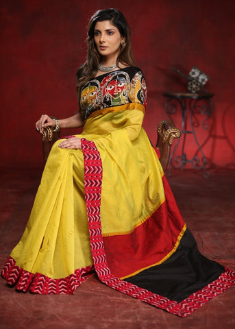 Yellow chanderi saree with hand batik in front and exclusive printed border