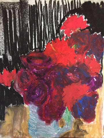 red carnations in blue vase