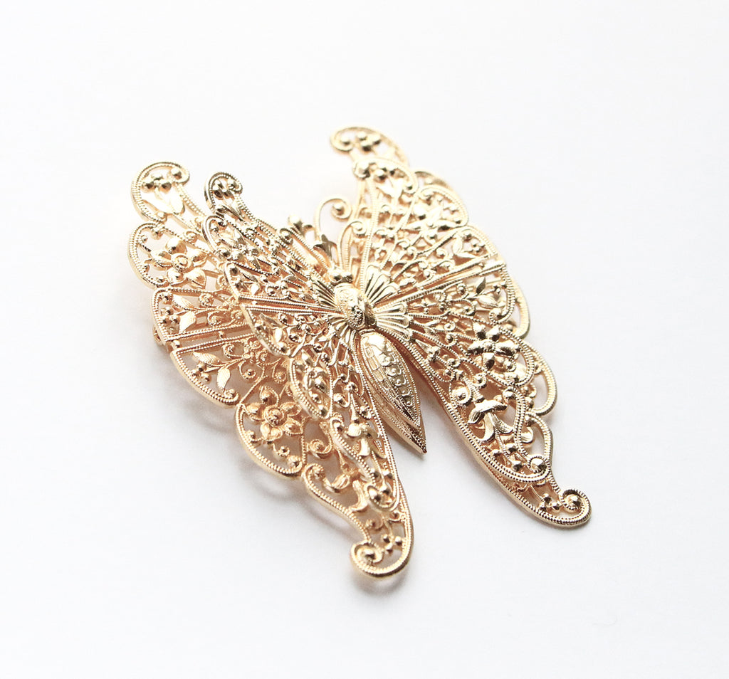Double Butterfly Brooch (Pale gold tone)
