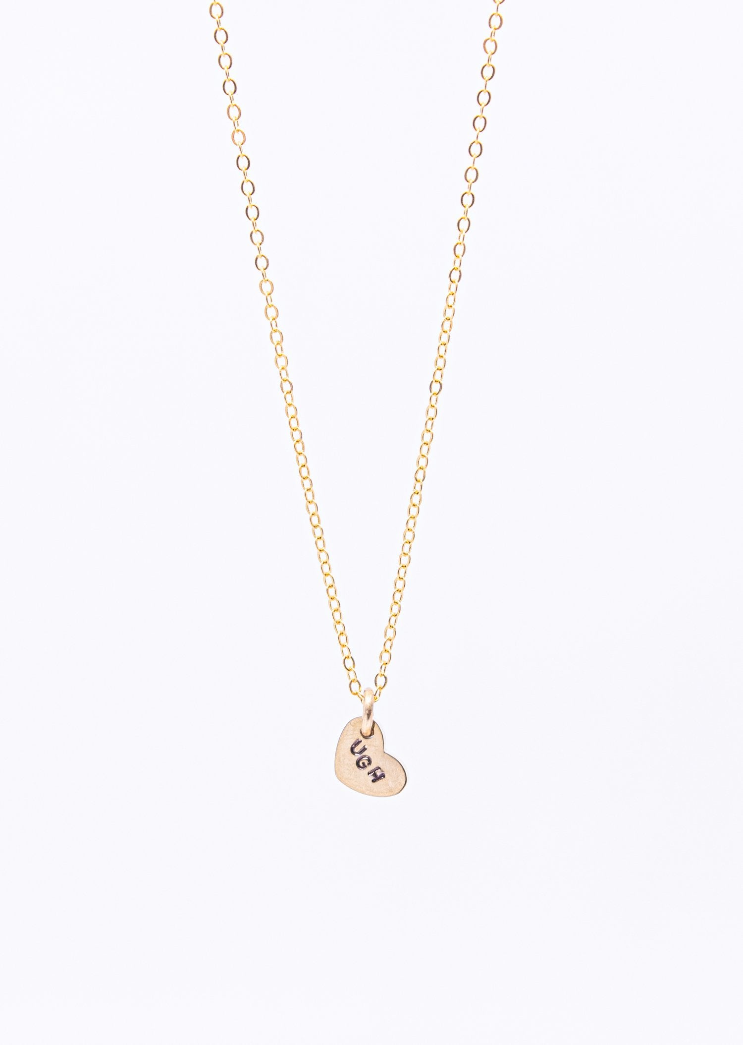 Squirrel Vs Coyote Ugh Stamped Heart Necklace Brass
