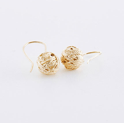 Yarn ball earrings in gold