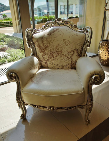 This beautiful leather chair has light-colored leather, which can be more prone to stains.