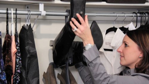 With the boots facing out, simply slide your boots on/off the hangers (1 of 2)