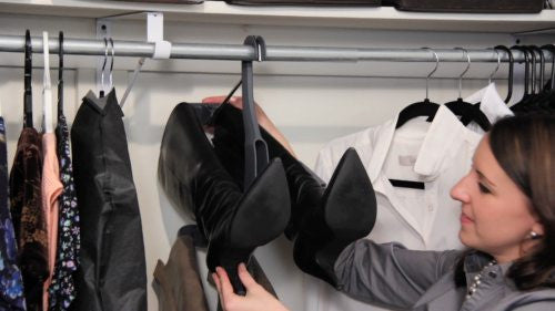 With the boots facing out, simply slide your boots on/off the hangers