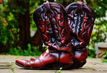 Distressed leather cowboy boots require different care