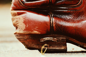 Use a pencil eraser to remove small scuffs on cowboy boots