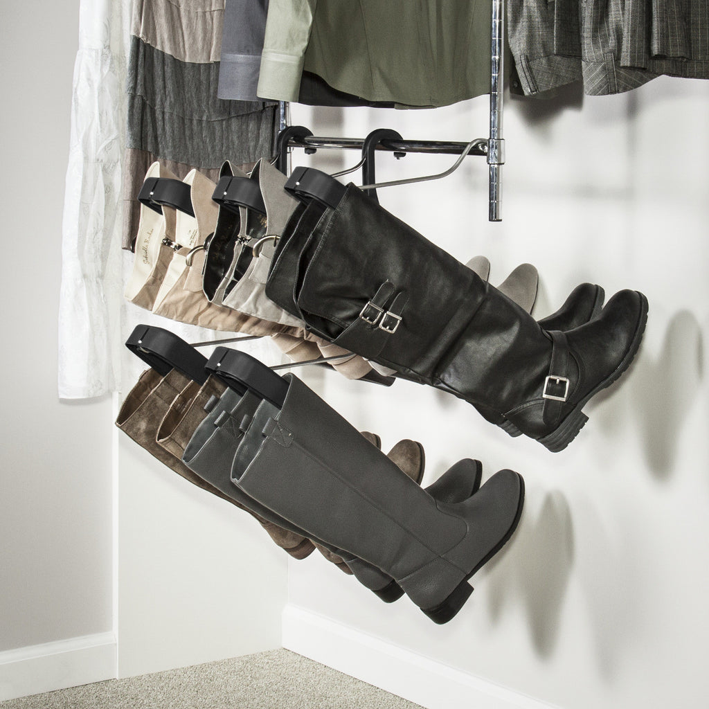 A Boot Butler 5-pair boot rack configured to hang from a closet doubler.