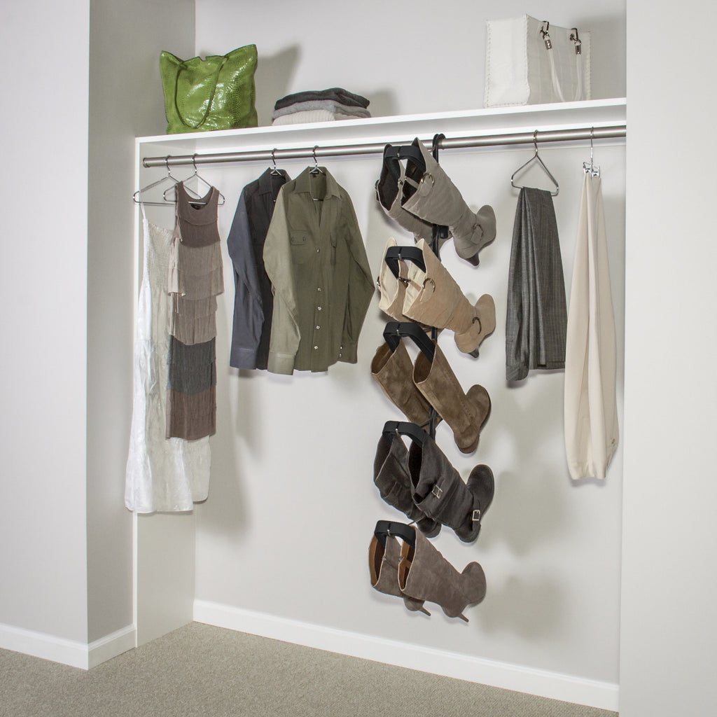 A Boot Butler 5-pair boot rack suspended from a standard height closet rod.