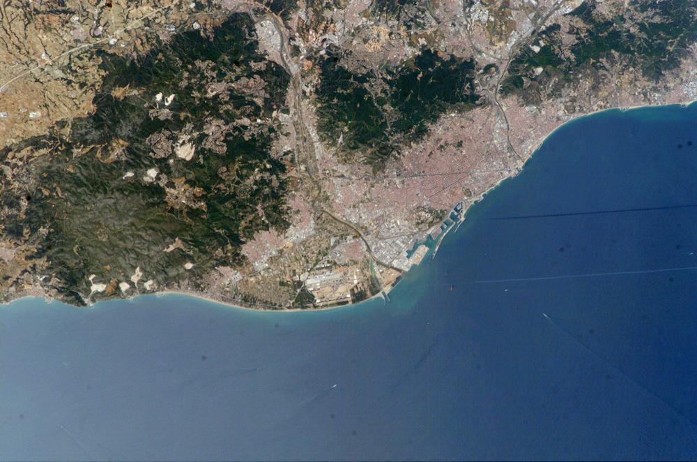 Barcelona hugging the Mediterranean Sea, a great place to bring your Pillowpacker travel pillow