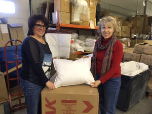 Nancy Simon of Marie L'Oie poses with a pillowpacker pillow