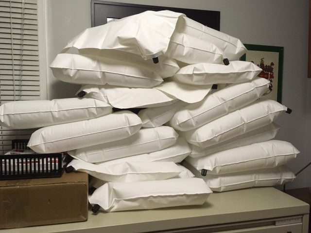 A stack of slightly deflated pillow liners