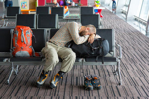 tired traveller at airport needs sleep