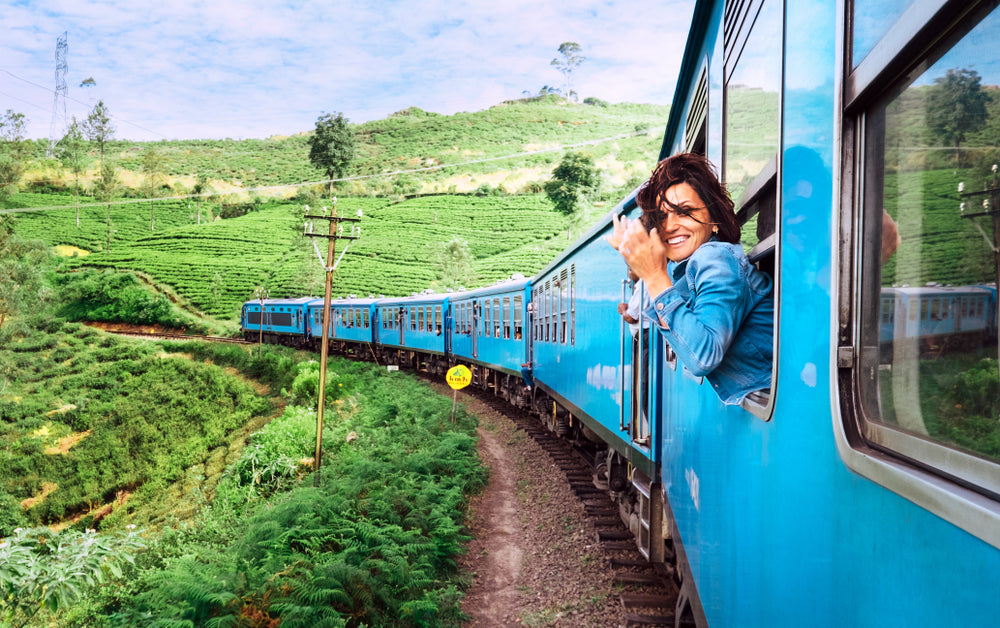 woman taking photo from train