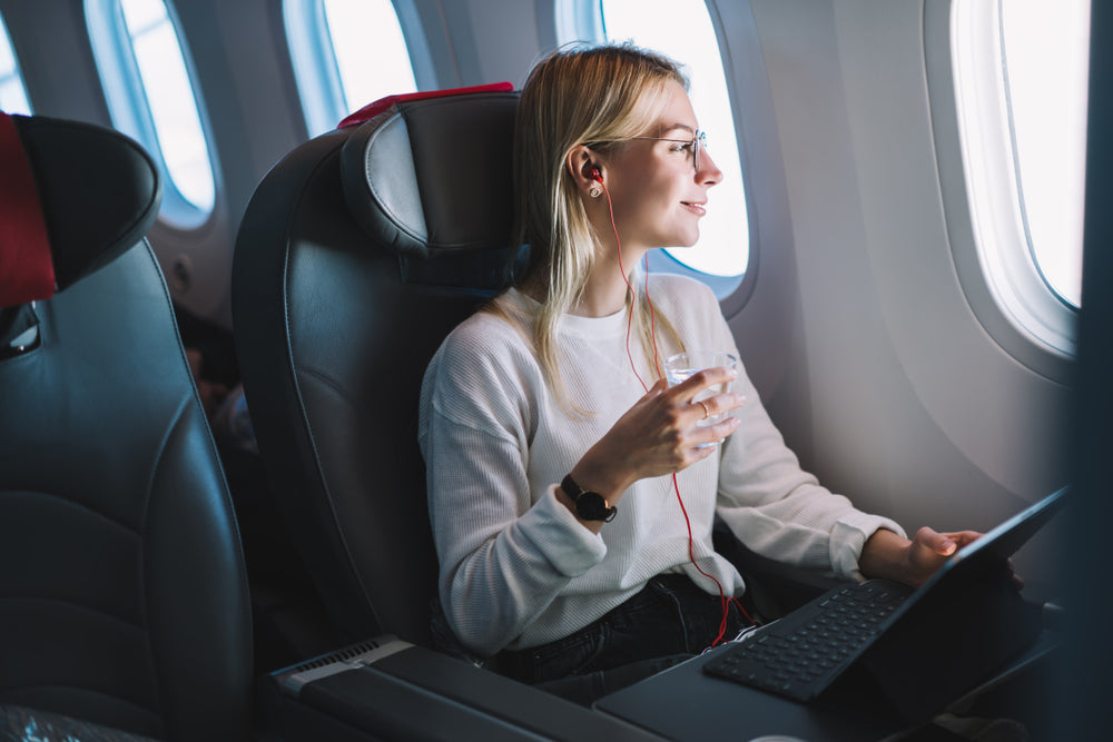 woman in airplane calmly looking out window