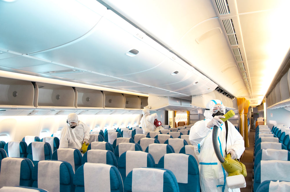 aircraft interior with sanitation crew during covid