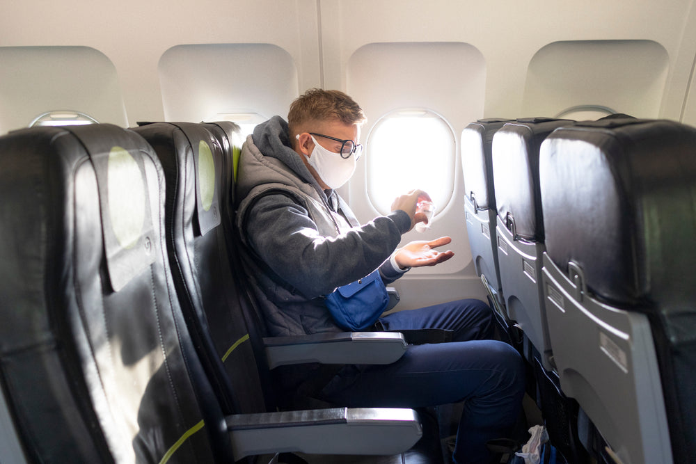 male traveller on aircraft during covid