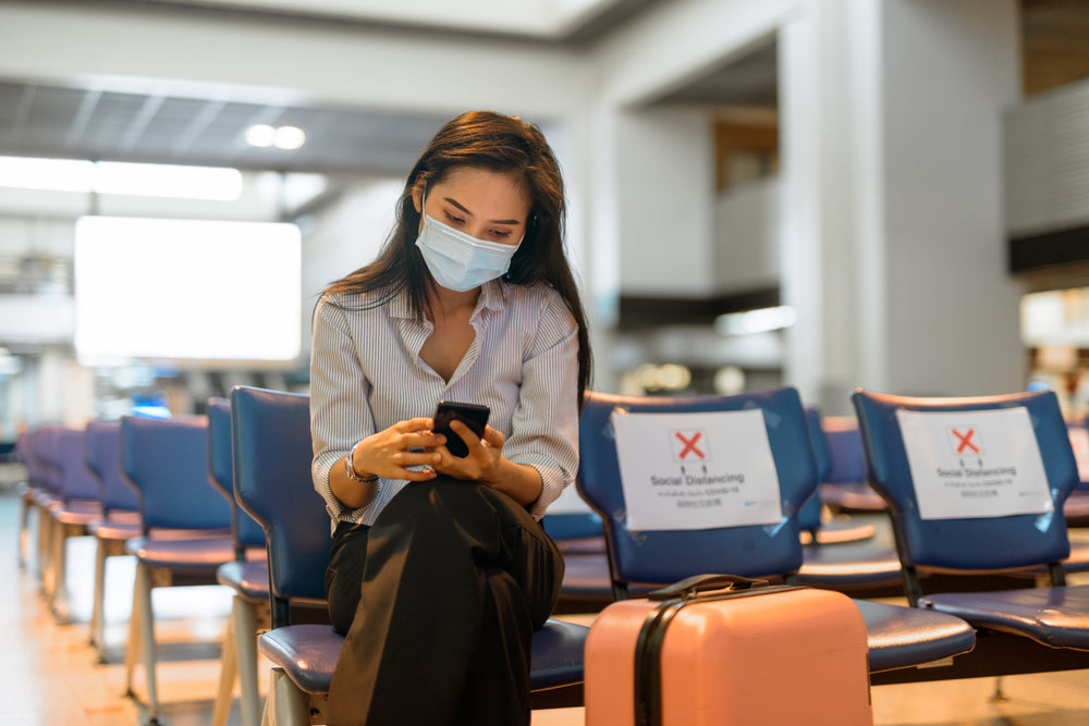 female traveller at airport during covid