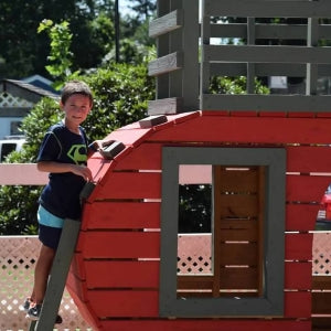child climging wooden play camper