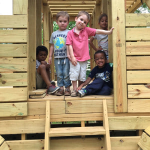 kids inside outdoor truck playhouse