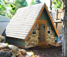 small, wooden a-frame playhouse for children with windows and stone