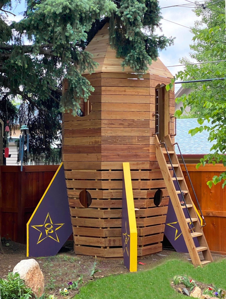 Wooden rocketship playset in backyard