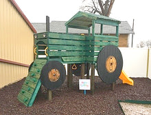 Elevated and modified, green painted tractor play-set