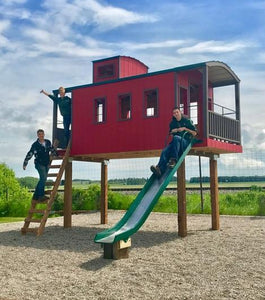 Elevated red caboose play-set with slide