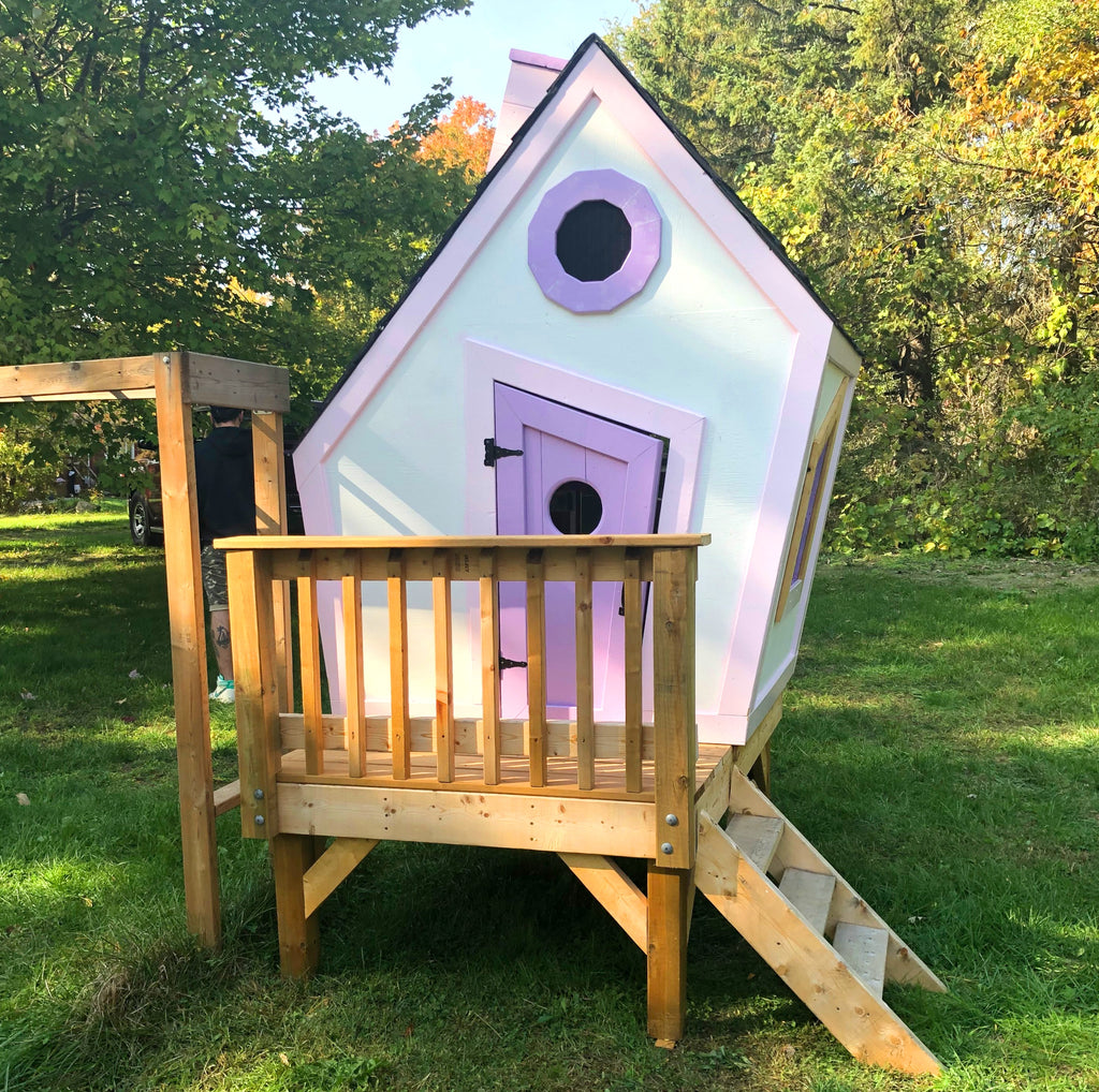 White and purple elevated whimsical playhouse