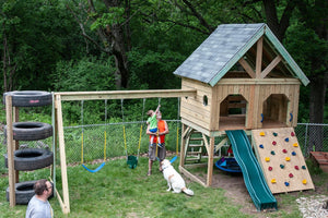 DIY backyard play-set plan with tire tower and rock wall