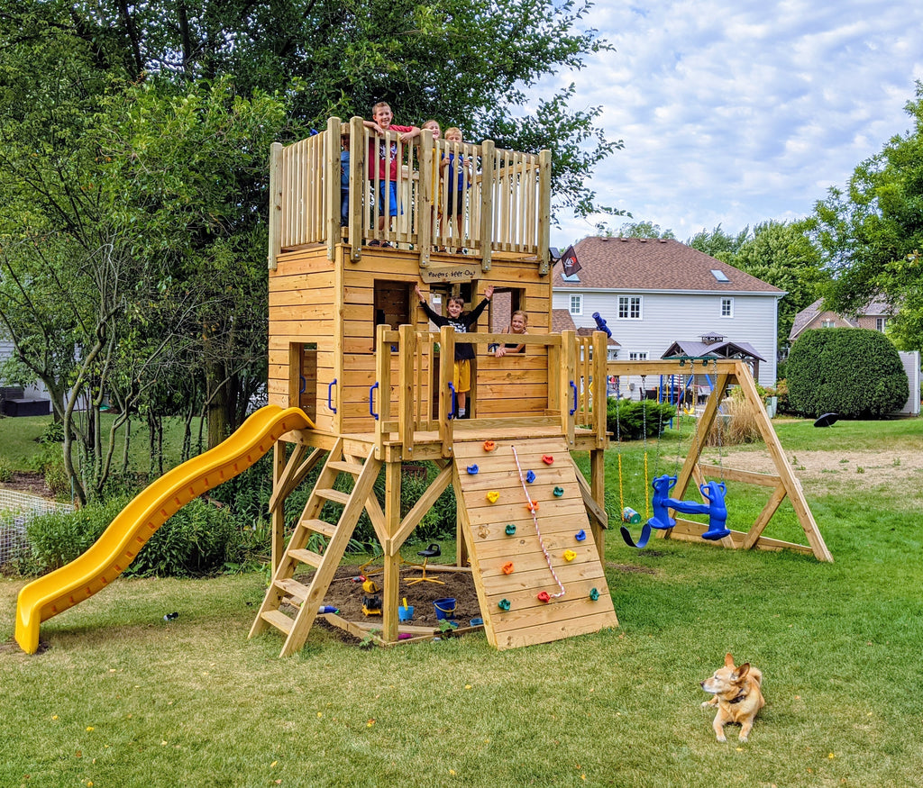 Group of kids playing on backyard, 3 level playset with swing set and slide