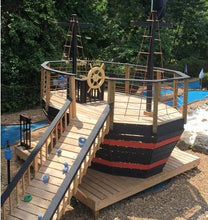 Outdoor children's pirate ship with gang plank