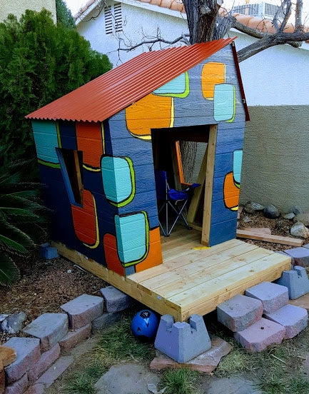 Colorful, crooked kid's playhouse made for toddlers