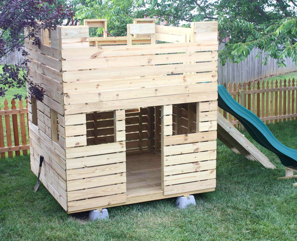 small wooden castle playhouse w/ slide and gang plank