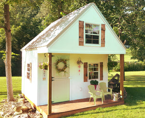 pretty outdoor playhouse with loft