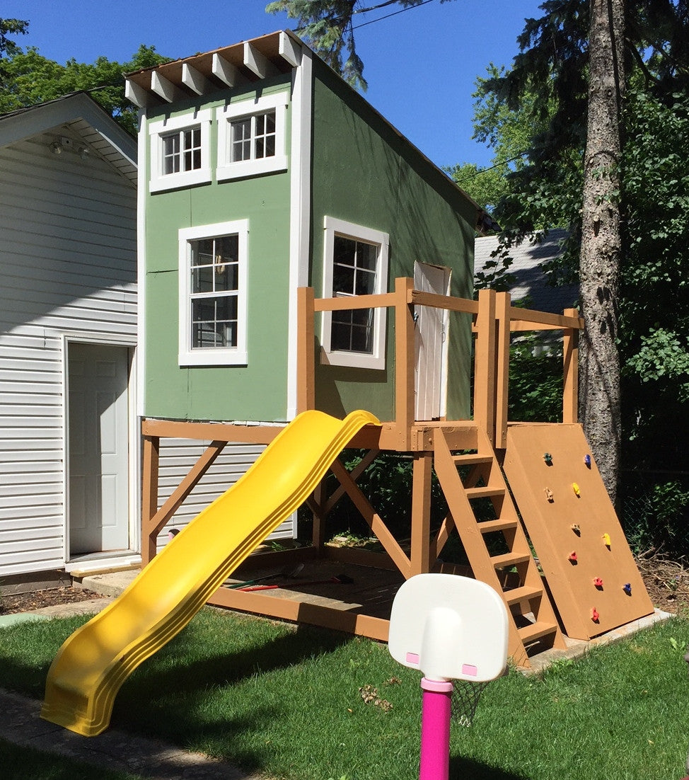 cool kids clubhouse with shed roof, slide and rock wall