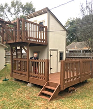 A two level, porch and balcony playhouse