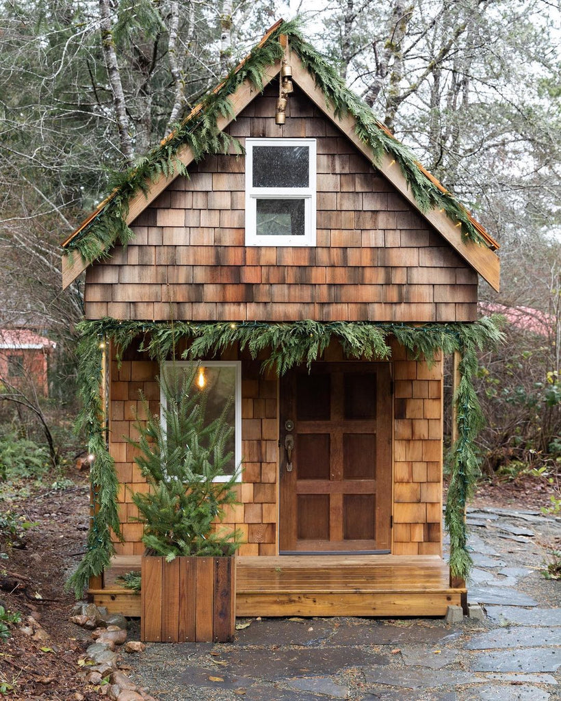 Cedar shake loft playhouse with Christmas garlands