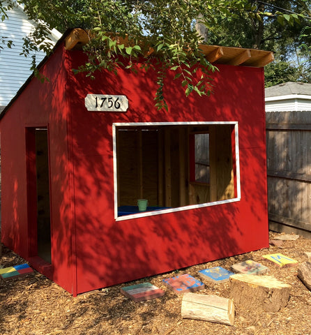 red backyard playhouse