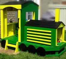 green and yellow wooden train play-set