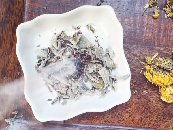 Sage smudging to cleanse room