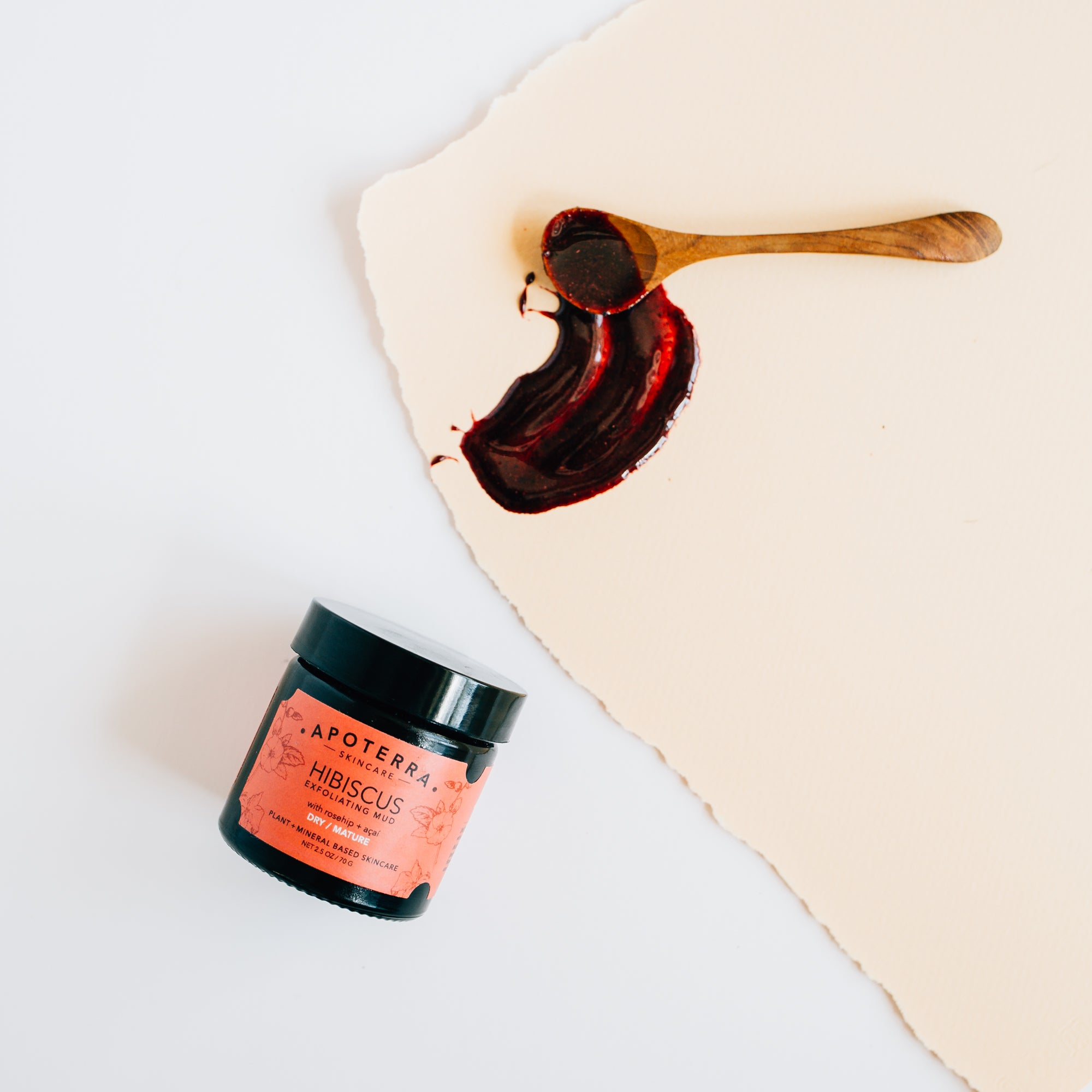 hibiscus exfoliating mud with spoon