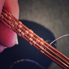 Handmade tie tack tie bar men's jewelry. Wire wrapped wire weaving in copper jewelry wire work.