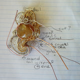handmade jewelry wire weave pendant sketches show design in gold, copper, silver, gems