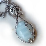 wire wrapped sterling silver pendant with pale teal blue amazonite