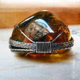 Bottom Amber & sterling silver custom wire wrapped setting