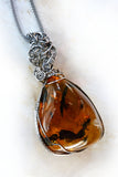 Amber & sterling silver custom wire wrapped setting