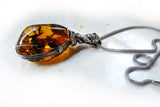 Alt side Amber & sterling silver custom wire wrapped setting
