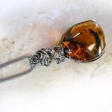 Top of Amber & sterling silver custom wire wrapped setting