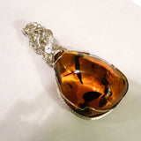 No patina Amber & sterling silver custom wire wrapping