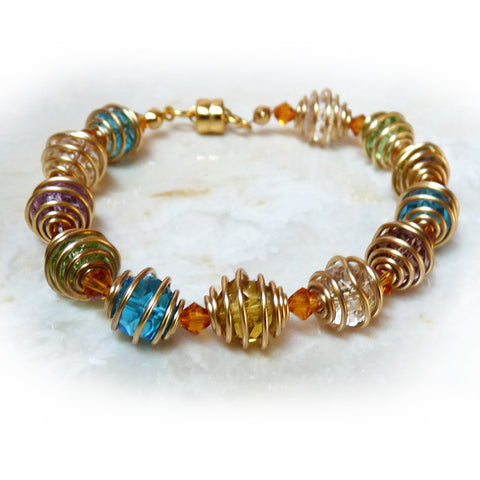 Colorful handmade wire wrapped bracelet. Crystal, bronze.